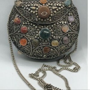 Selling this beautiful purse with stones